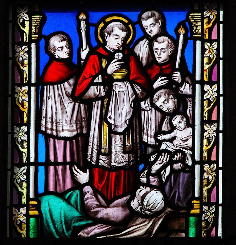 BRUSSELS, BELGIUM - MARCH 13, 2017: Stained Glass in the Church of Our Blessed Lady of the Sablon in Brussels, Belgium, depicting Saint Charles Borromeo or Carolus Borromeus